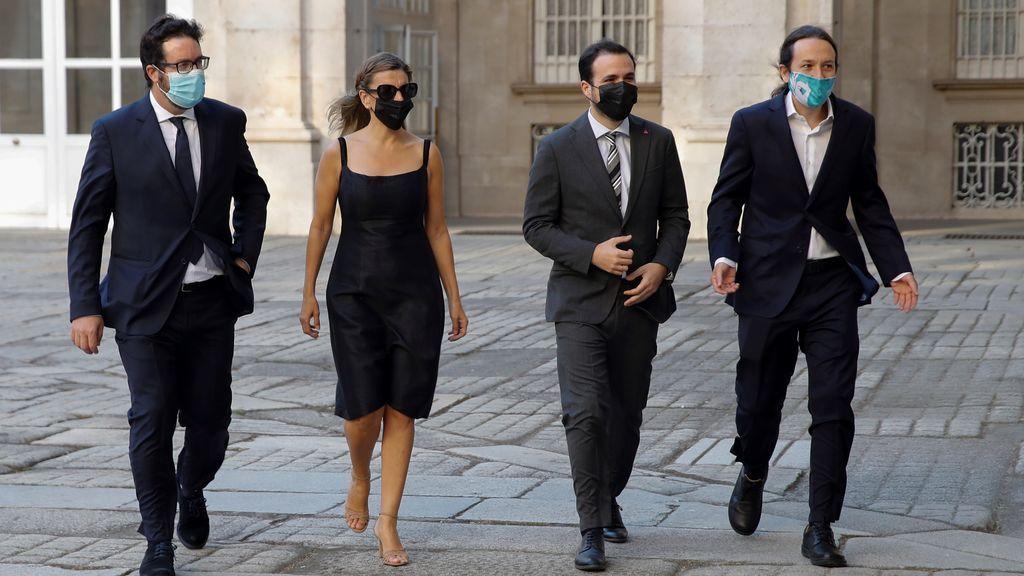 La ministra de Trabajo y Economía Social, Yolanda Díaz, el ministro de Consumo, Alberto Garzón, y el vicepresidente segundo del Gobierno, Pablo Iglesias