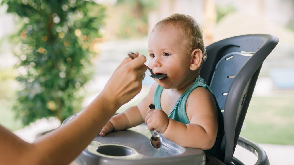 photo-of-baby-eating-on-a-chair-4669020