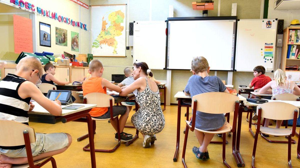 Niños atendiendo a una clase.