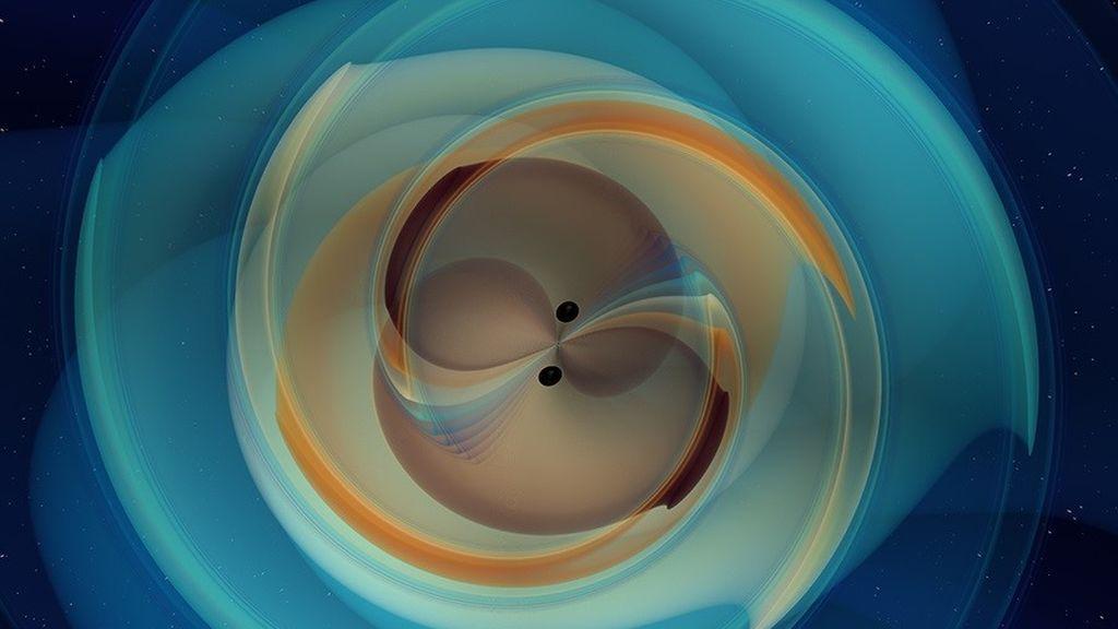 EuropaPress_3297066_simulacion_numerica_dos_agujeros_negros_inspiran_fusionan_emitiendo_ondas