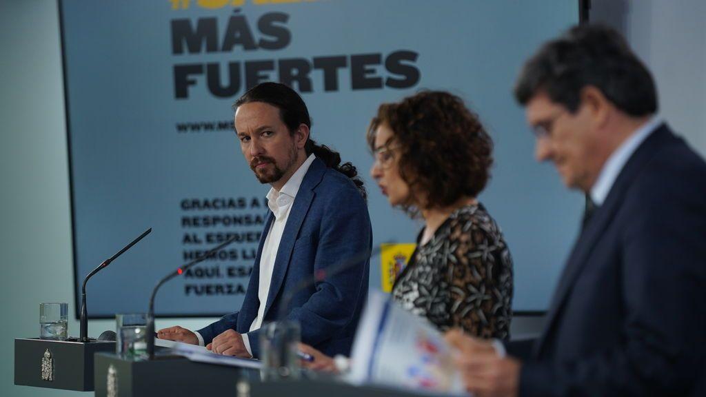 Escrivá, Montero e Iglesias, en la rueda de prensa del 29 de mayo