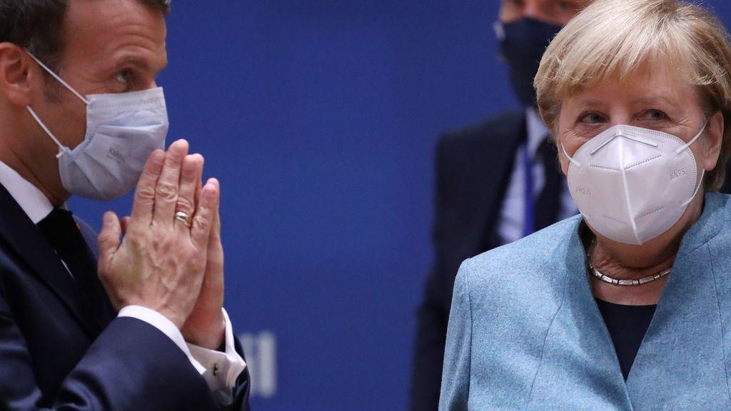 Macron y Merkel piden reforzar la frontera de la UE y endurecer el asilo para hacer frente al terrorismo