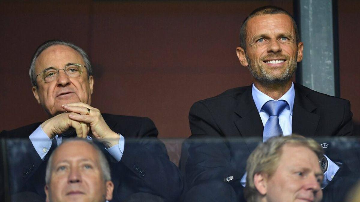 Florentino Pérez y Ceferín, presidente de la UEFA.