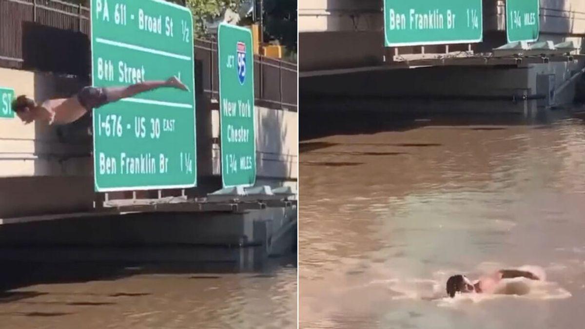 Realiza un espectacular salto de espaldas en las aguas que inundan una carretera en Filadelfia