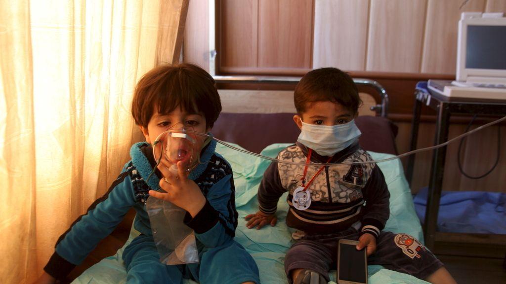 Niños afectados por una atque en Irak