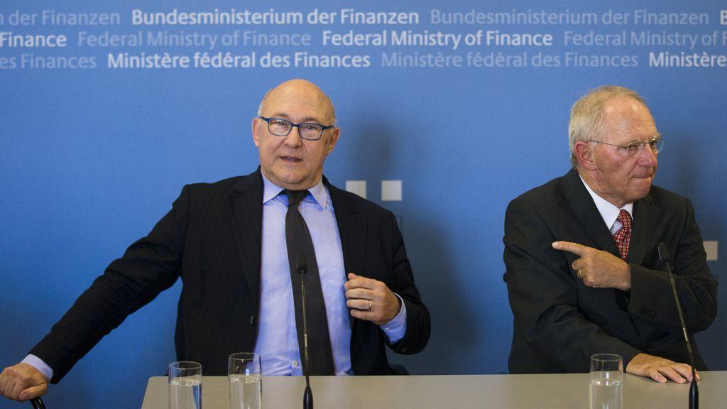 Michel Sapin y Wolfgang Schaeuble, ministros de Finanzas de Francia y Alemania