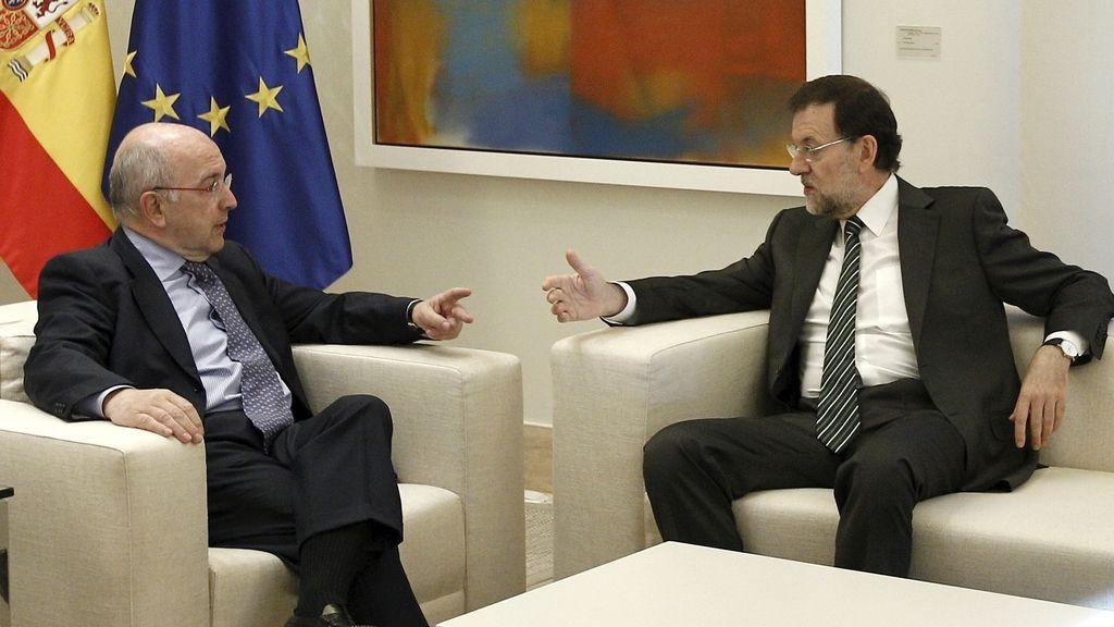 Almunia y Rajoy.
