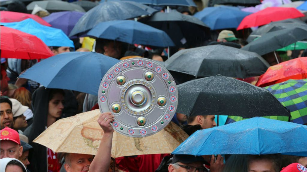 Paraguas y escudo