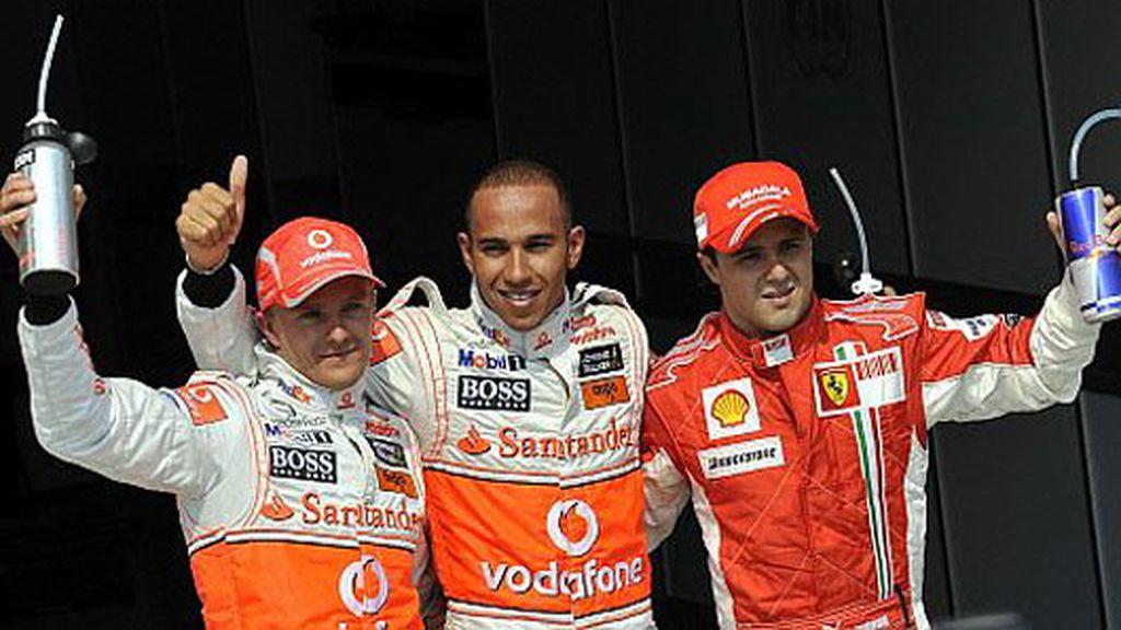 Hamilton, Kovalainen y Massa saludan tras la clasificación