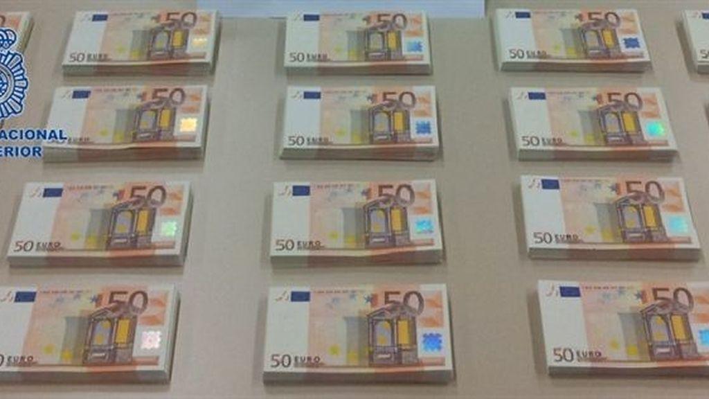 Detenidas once personas de dos bandas por falsificar billetes de 50 euros