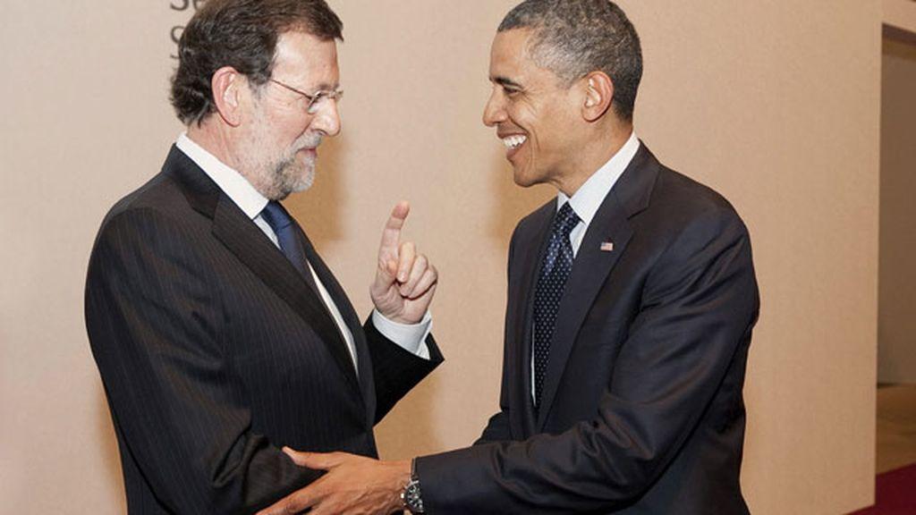 Saludo entre el presidente de Estados Unidos, Barak Obama, y el jefe del Ejecutivo español, Mariano Rajoy