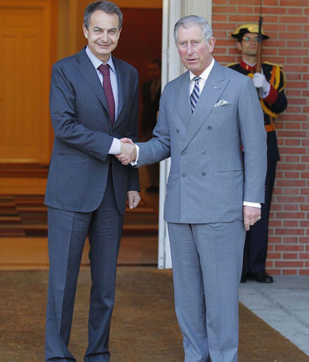Con el Príncipe de Gales en 2011