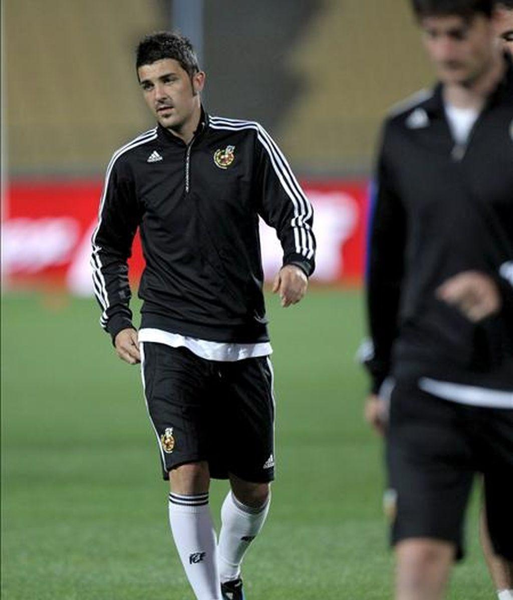 El delantero de la selección española David Villa durante el entrenamiento que el equipo ha llevado a cabo en el estadio Royal Bafokeng, en Rustenburgo (Sudáfrica), de cara al partido de la Copa Confederaciones que disputarán mañana frente a Nueva Zelanda. EFE