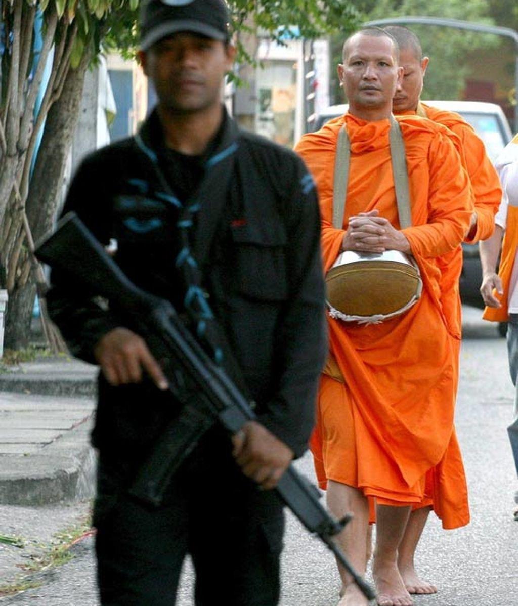 Monjes Budistas escoltados