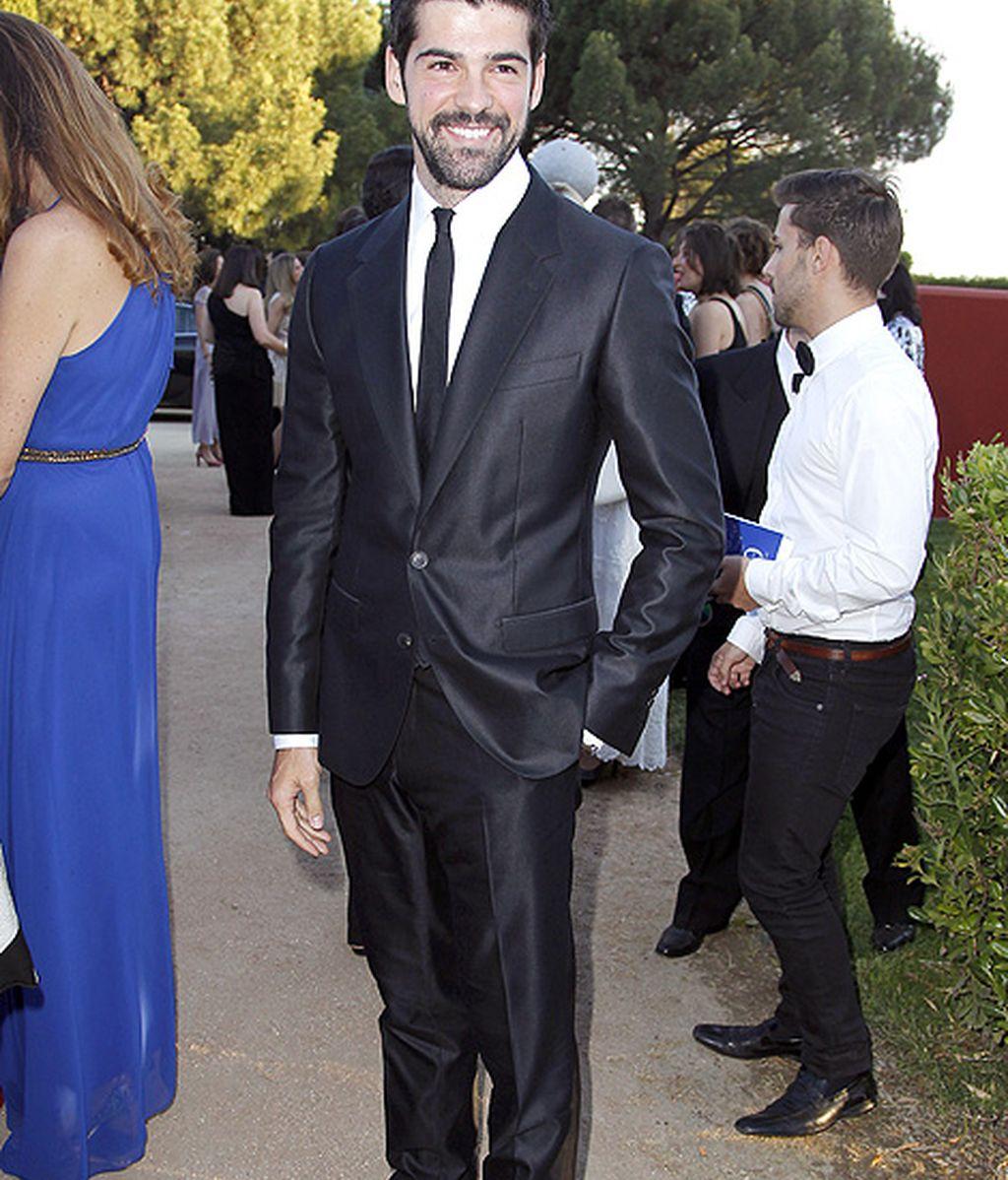 Miguel Ángel Muñoz, con traje negro y corbata