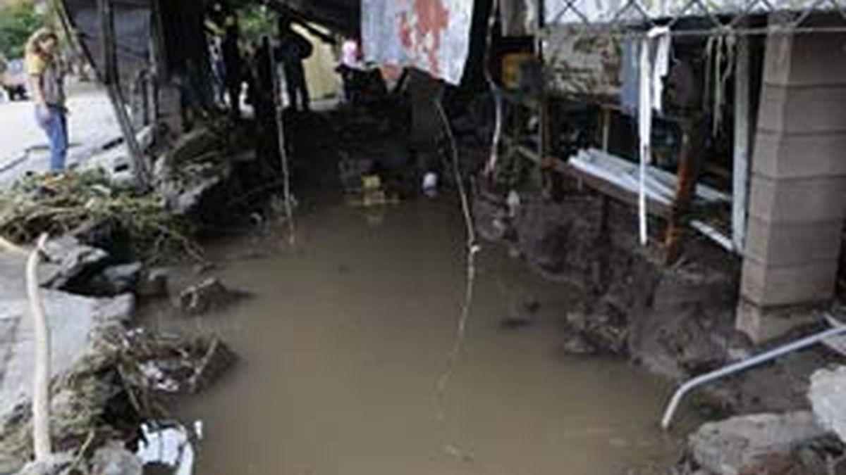 Detalle de una vivienda afectada por las lluvias en San Salvador. Foto:EFE