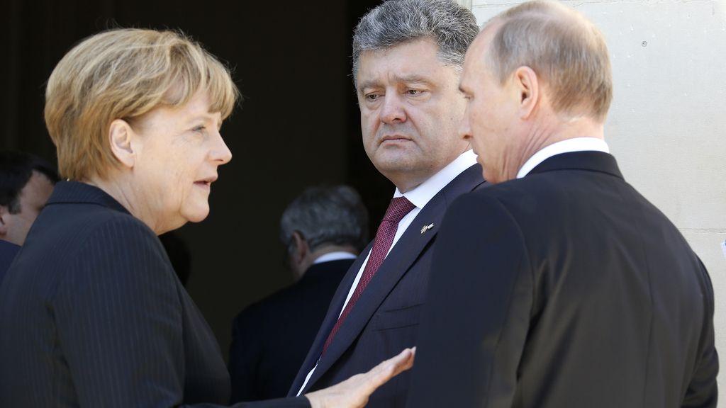 Putin,Poroshenko y Angela Merkel