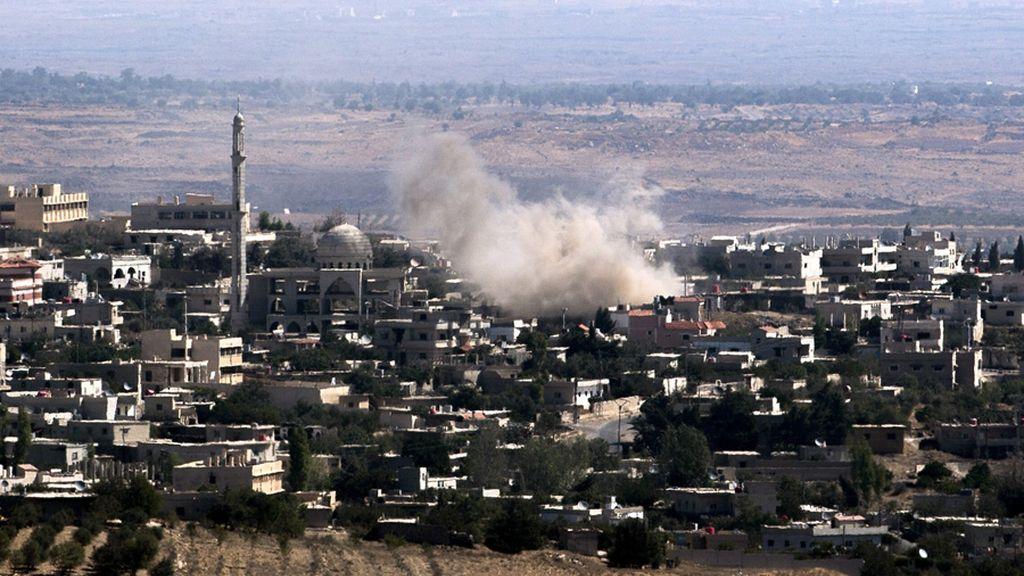 Humo en un pueblo sirio