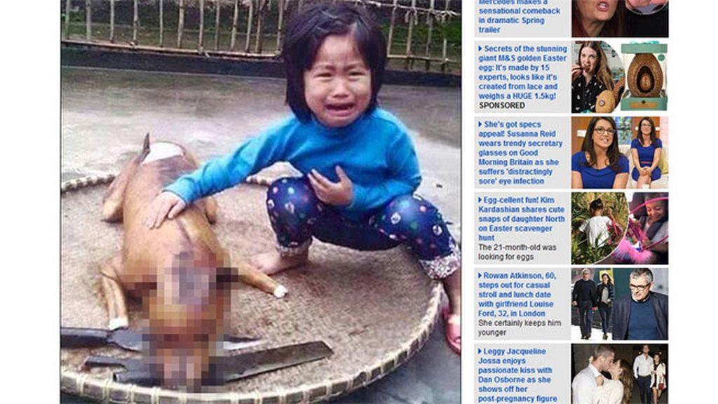 Una niña vietnamita reconoce a su perro desaparecido en un puesto de comida