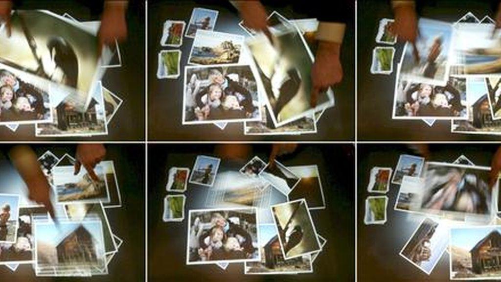 """Combo de fotografías que muestran a un empleado trabajando con la mesa computerizada """"Microsoft Surface"""". EFE/Archivo"""