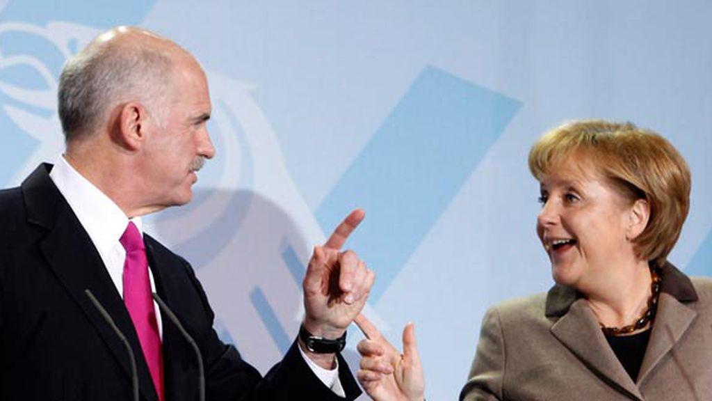 Giorgios Papandreu y Ángela Merkel