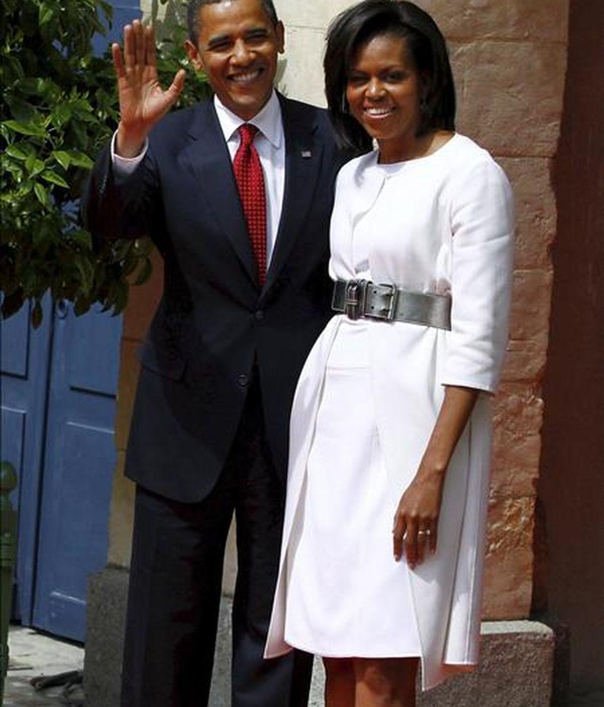 El presidente estadounidense, Barack Obama y su mujer Michelle, ayer en Francia. EFE