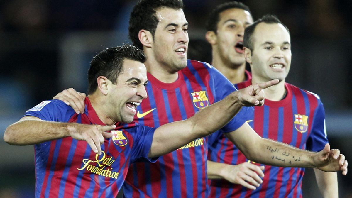 Xavi y Busquets durante un partido de Liga