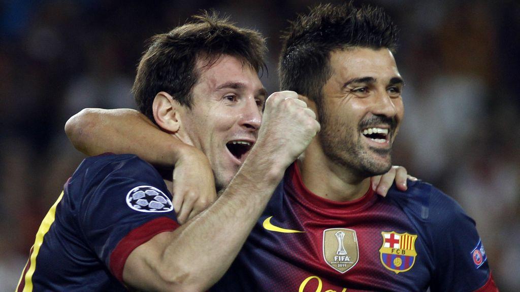 Messi y Villa celebrando un gol del argentino
