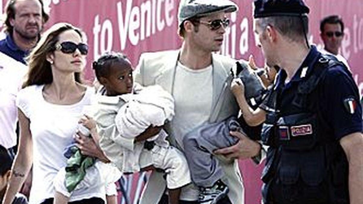 La pareja fotografiada recientemente en Venecia con dos de sus hijos.