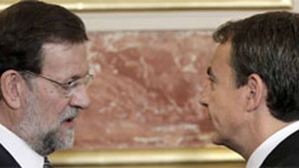 El presidente del Gobierno y el líder del PP negocian directamente. Foto: Archivo/EFE.
