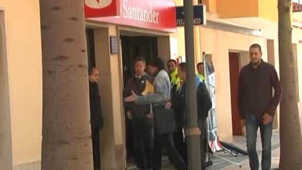 Muere una mujer en un atraco a un banco