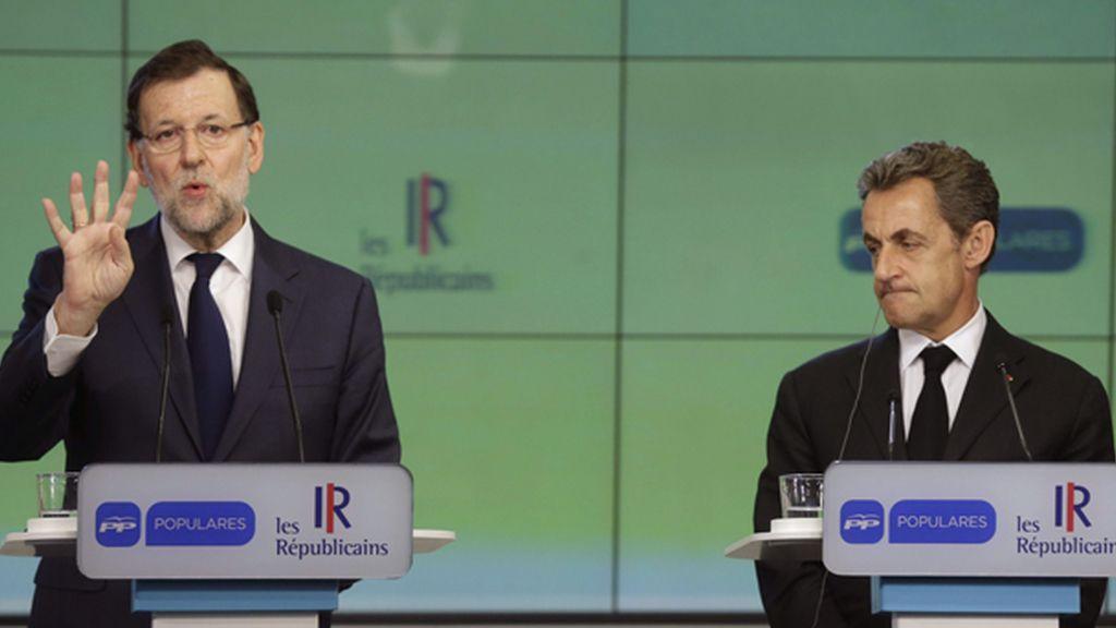 Rajoy recibe a Sarkozy en la sede del PP