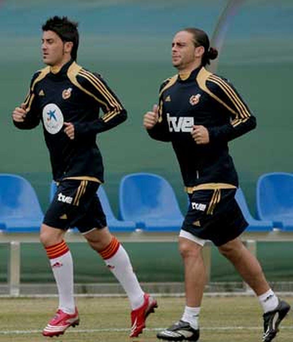 Villa y Sergio García, al margen del grupo. Foto: EFE