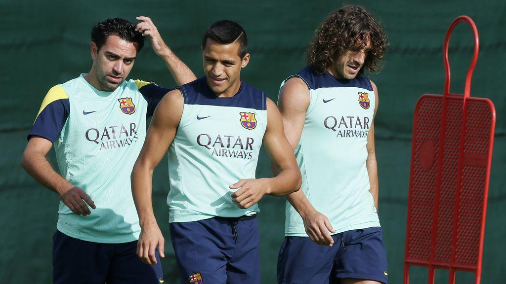 Xavi Hernández, Alexis Sánchez y Carles Puyol