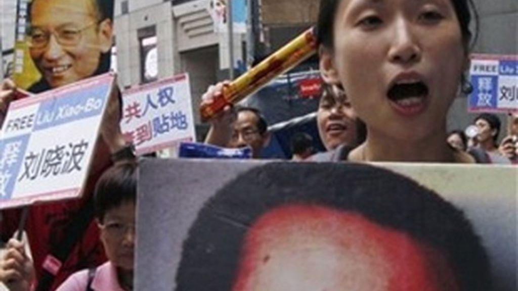 Manifestantes en apoyo al Premio Nobel de la Paz, Liu Xiaobo. Foto: AP