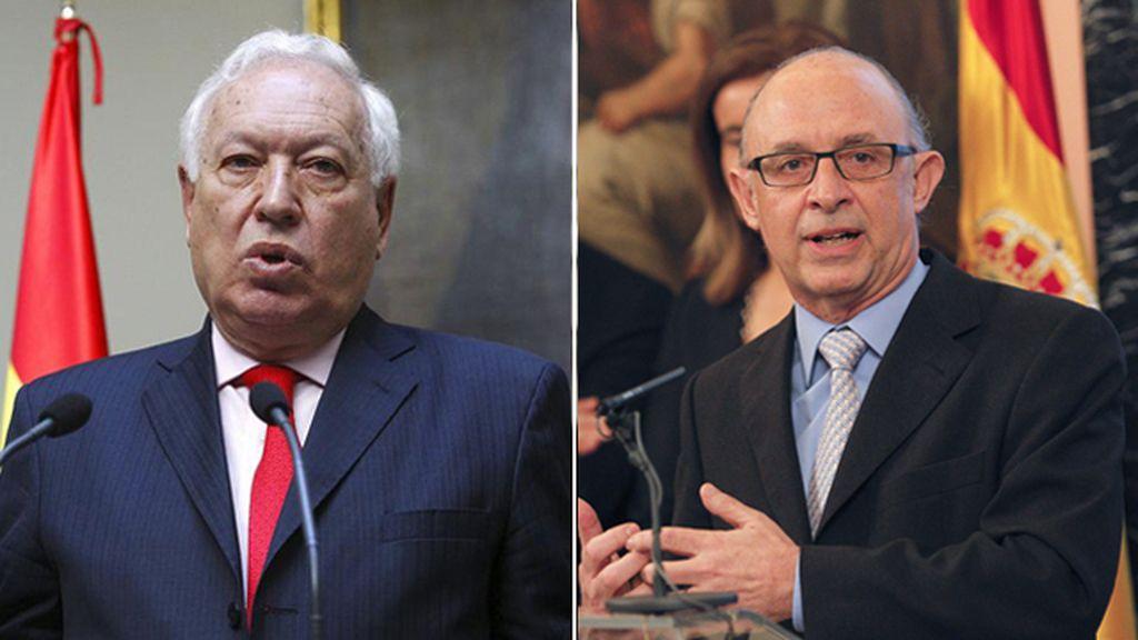 Los ministros José Manuel García-Margallo y Cristóbal Montoro
