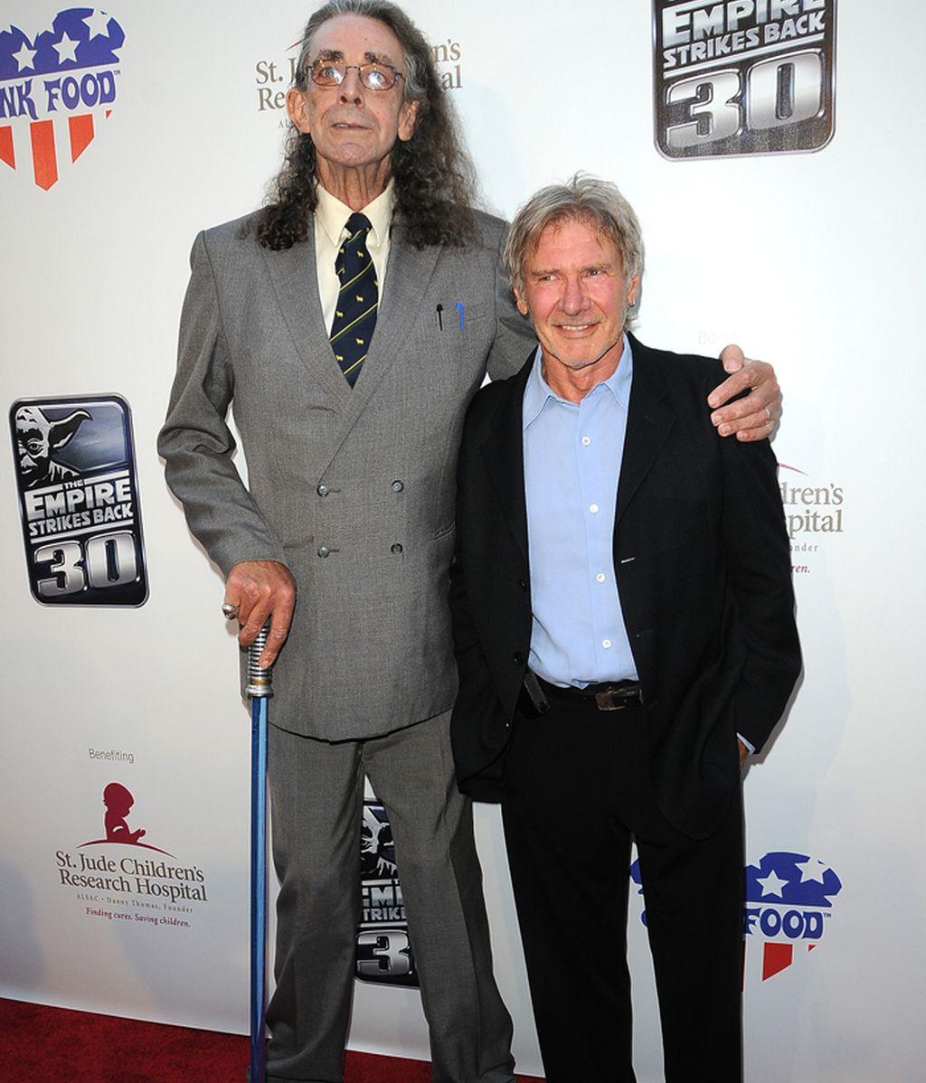 Peter Mayhew y Harrison Ford durante un acto benéfico.
