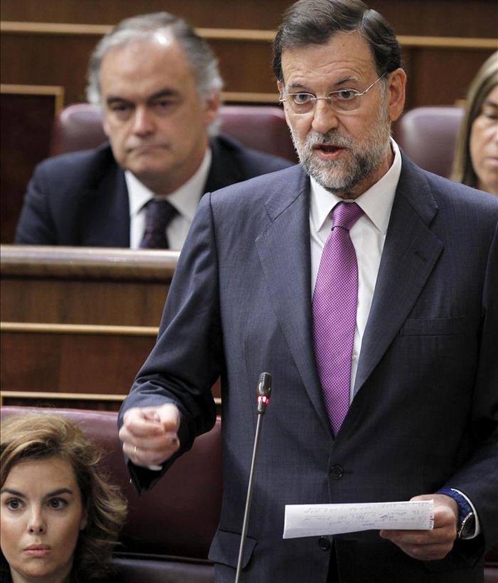 El presidente del PP, Mariano Rajoy, en una de sus intervenciones de la sesión de control al Gobierno del pleno del Congreso de hoy. EFE