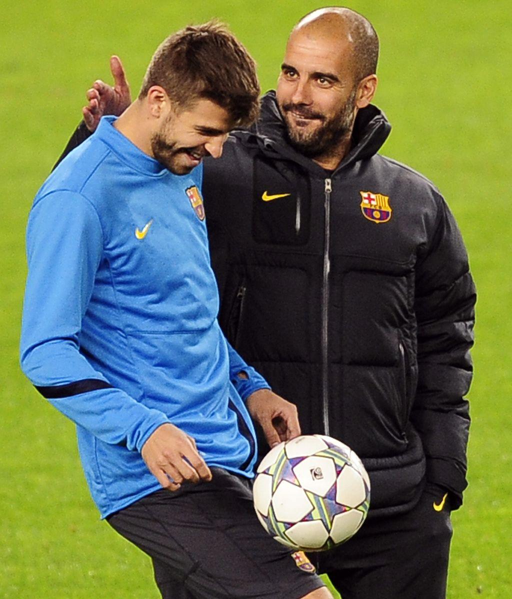 Piqué y Guardiola durante un entrenamiento