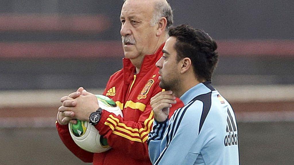 Xavi y Del Bosque, en un entrenamiento