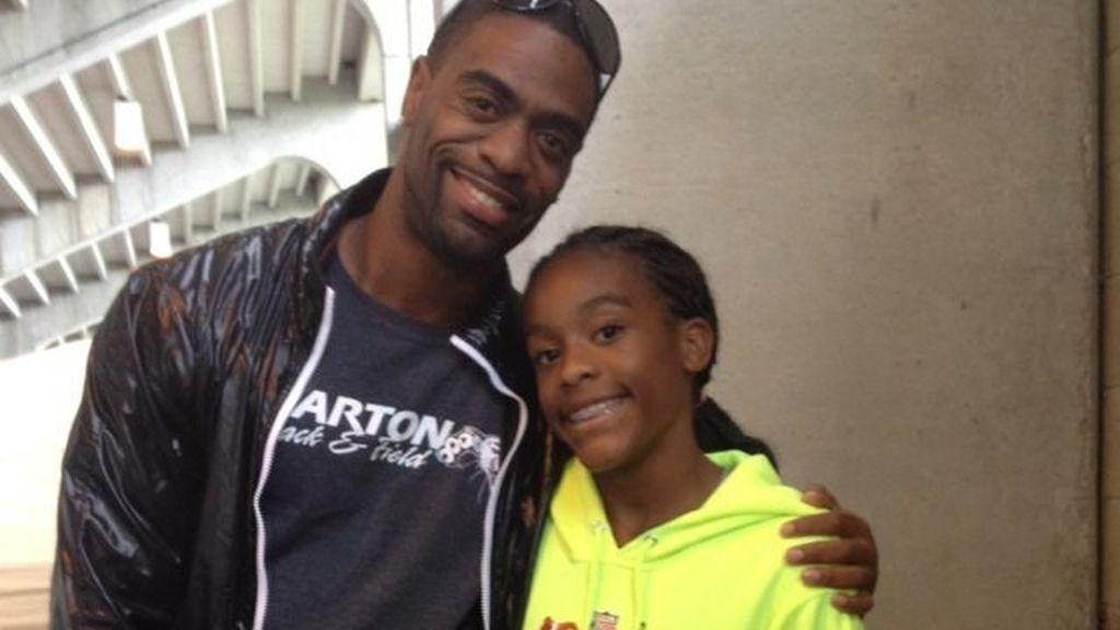 El velocista estadounidense Tyson Gay y su hija asesinada