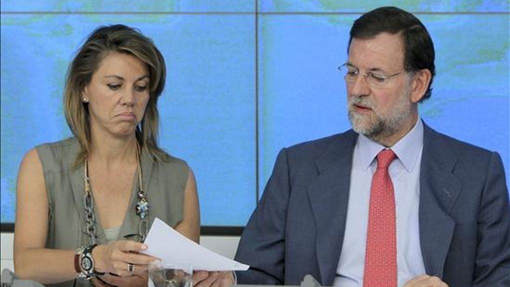 El presidente del PP, Mariano Rajoy, junto a la secretaria general del Partido Popular, María Dolores de Cospedal, durante la reunión del Comité Ejecutivo Nacional celebrada hoy con la que el PP cierra el curso político. EFE