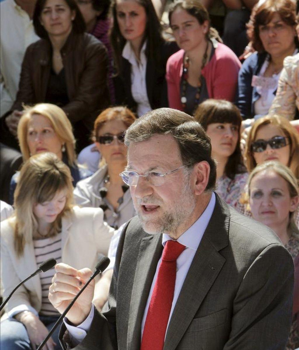 El presidente del PP, Mariano Rajoy, durante su intervención hoy en la convención de candidatas del PP a las próximas elecciones municipales y autonómicas que ha tenido lugar en el Centro Cultural Galileo de Madrid. EFE