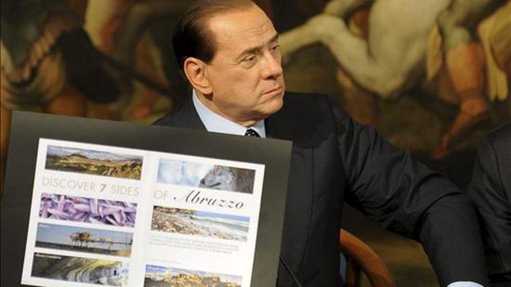 El primer ministro italiano, Silvio Berlusconi, hoy en Roma durante la presentación de un nuevo logotipo turístico. EFE