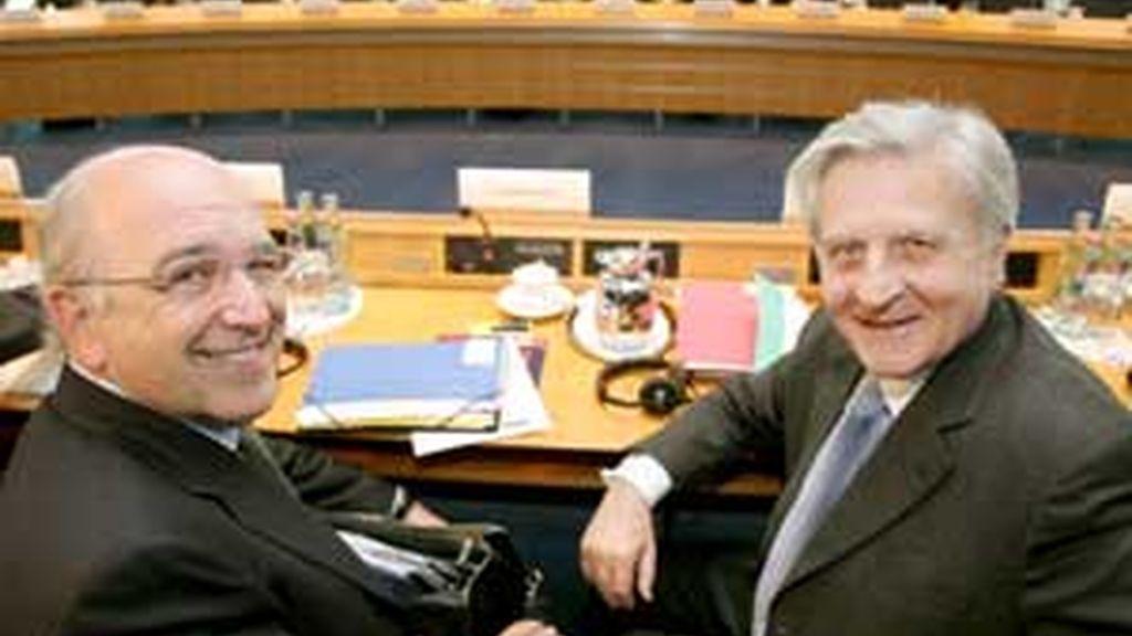 Jean-Claude Trichet junto a Joaquín Almunia en la reunión celebrada en Alemania. FOTO: EFE