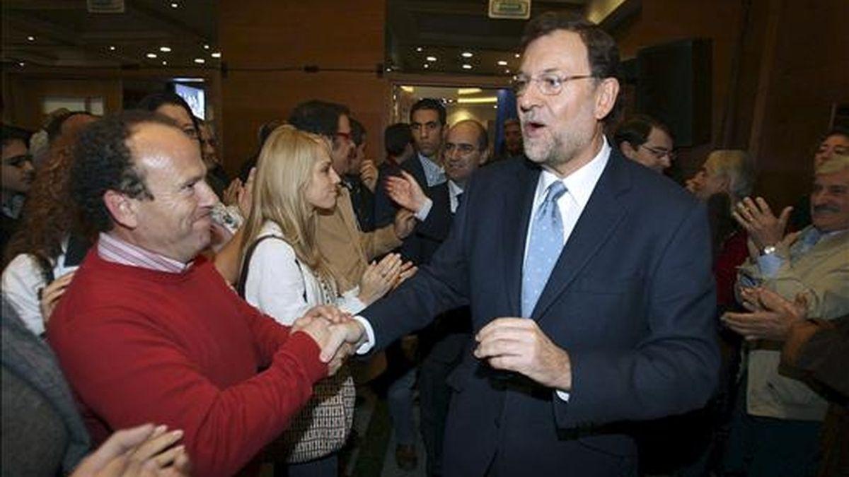 El presidente nacional del PP, Mariano Rajoy, participó hoy en Salamanca en una convención regional del PP de Castilla y León, en la que también intervino Juan Vicente Herrera, que dirige el partido y el Gobierno regional. EFE