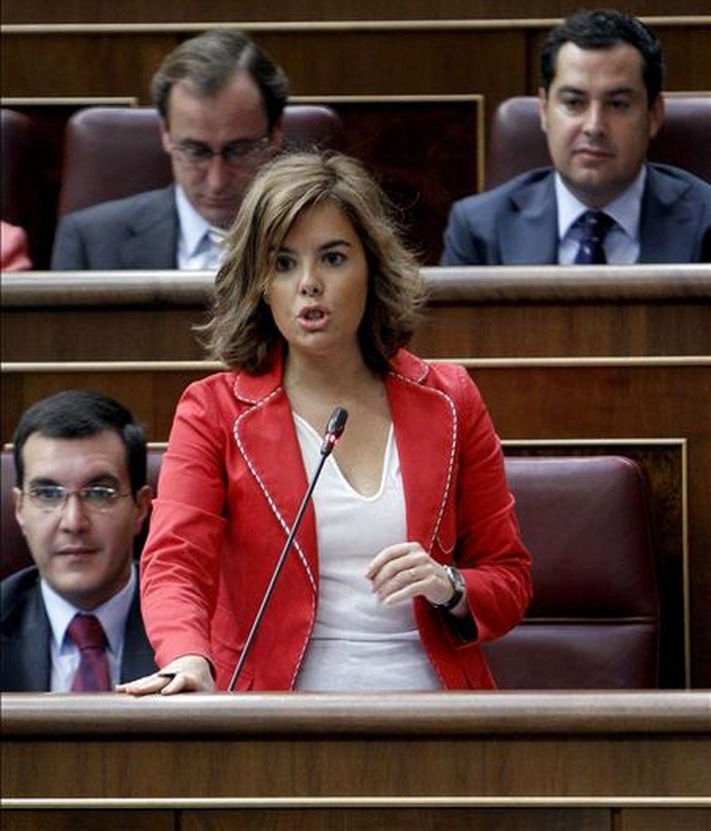 La portavoz parlamentaria del PP, Soraya Sáenz de Santamaría, durante una de sus intervenciones en un pleno celebrado en el Congreso de los Diputados. EFE/Archivo