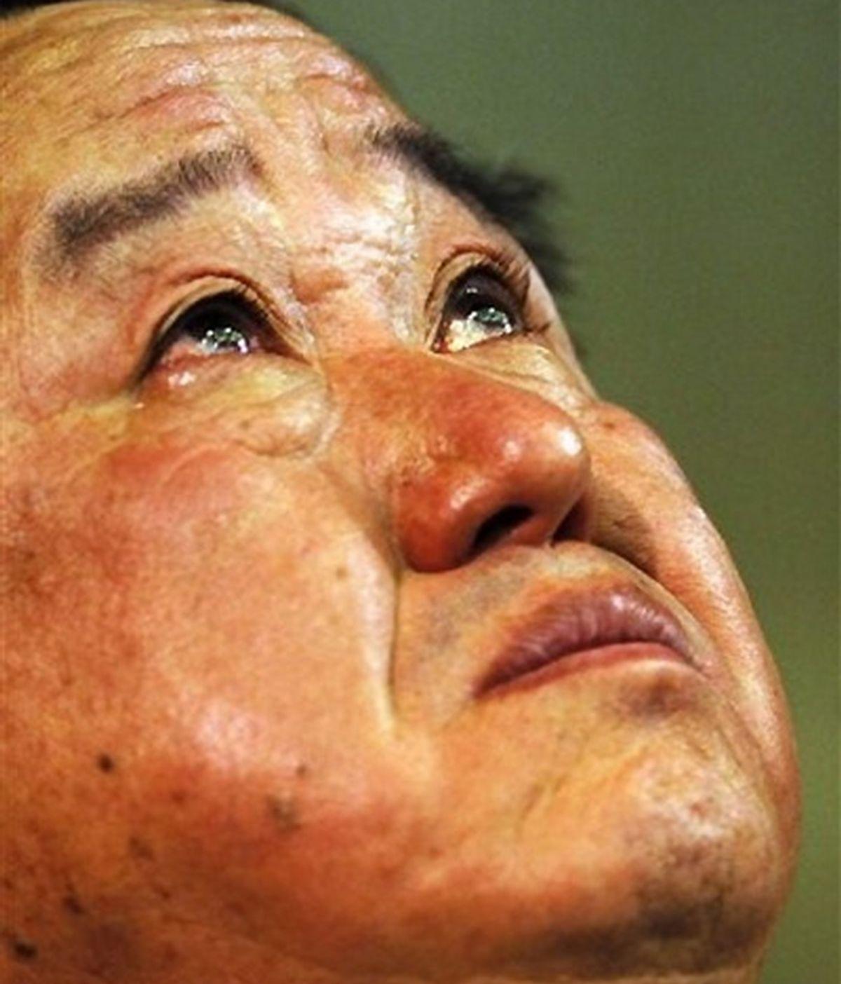Tadashi Yamashina, director de la escudería japonesa, no pudo reprimir las lágrimas en la rueda de prensa de despedida. FOTO: AP.