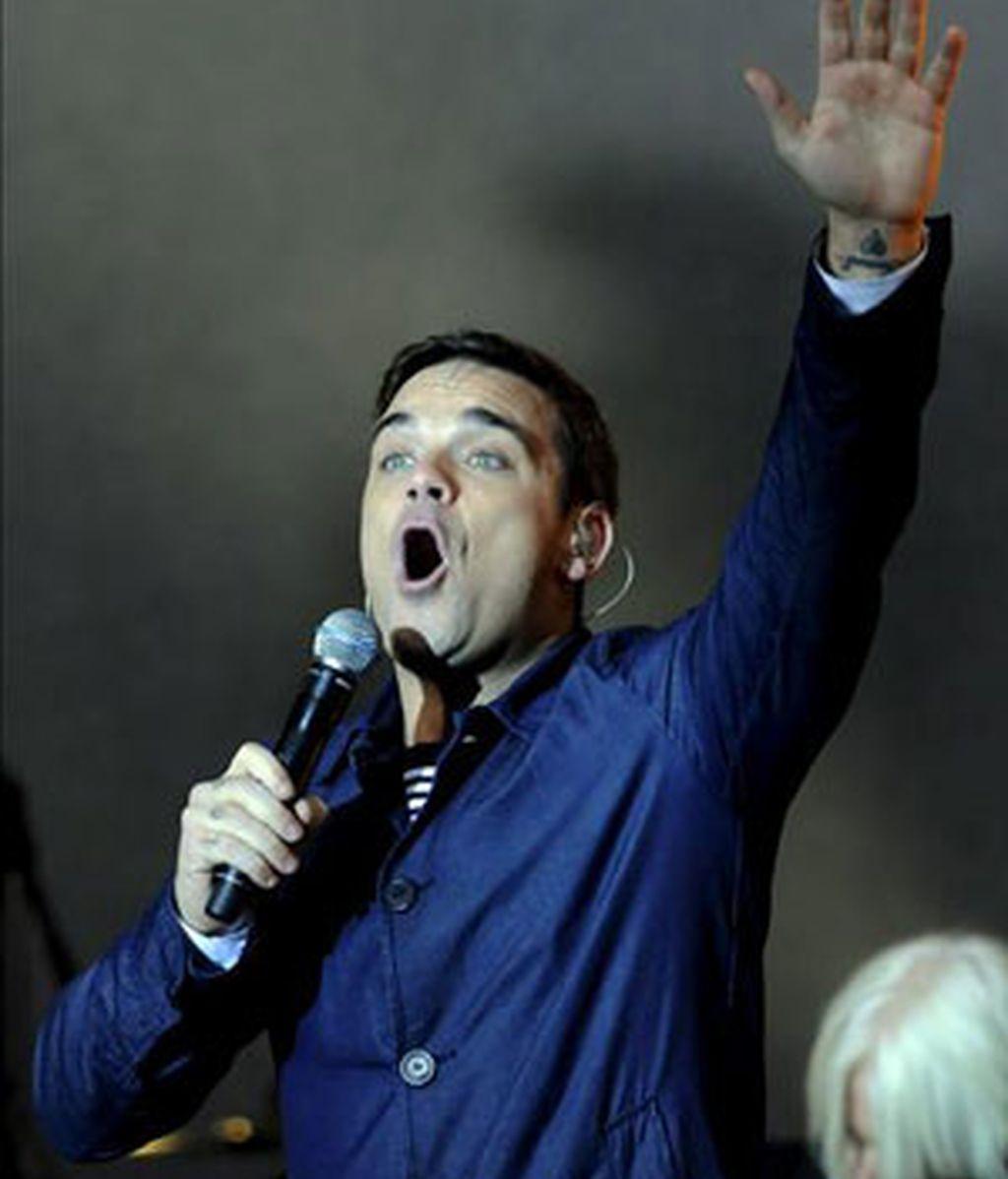 Robbie Williams confirma que cantará con Take That otra vez. Foto archivo EFE