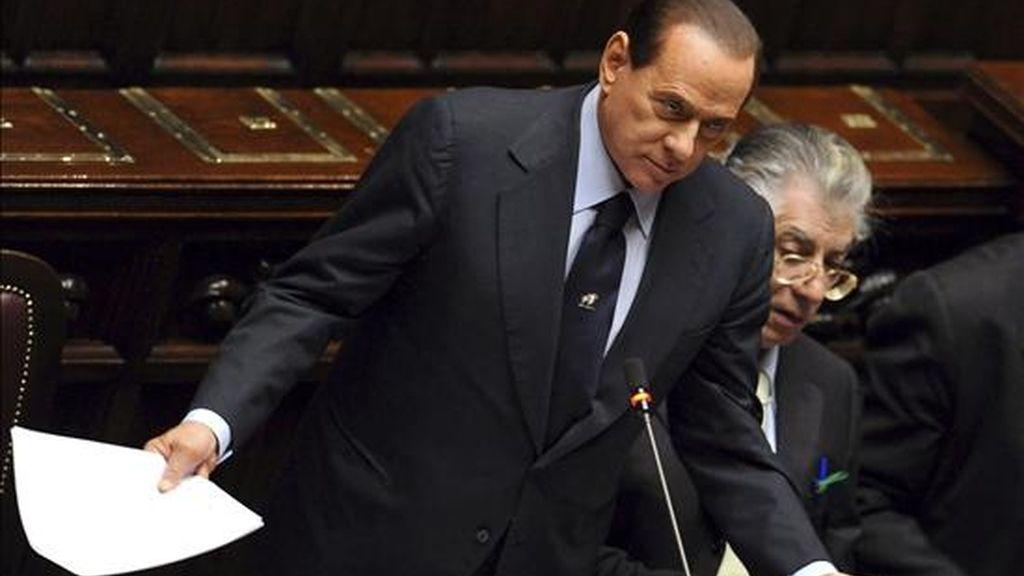 El primer ministro italiano Silvio Berlusconi interviene durante la sesión celebrada en el Senado italiano. EFE